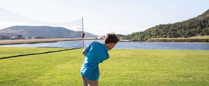 Relax and unwind at the driving range - Hamilton Island golf holidays