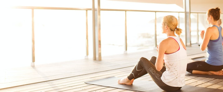 Relax with yoga on the Bommie deck - Hamilton Island luxury resorts