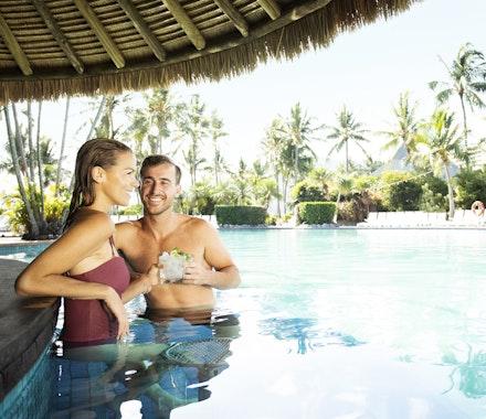 couple at swim up bar hamilton island swimming pool