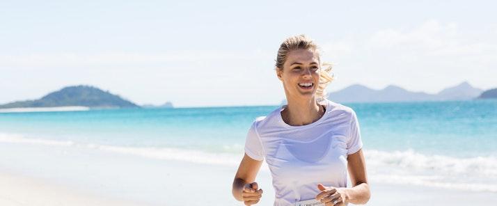running at Whitehaven Beach near Hamilton Island