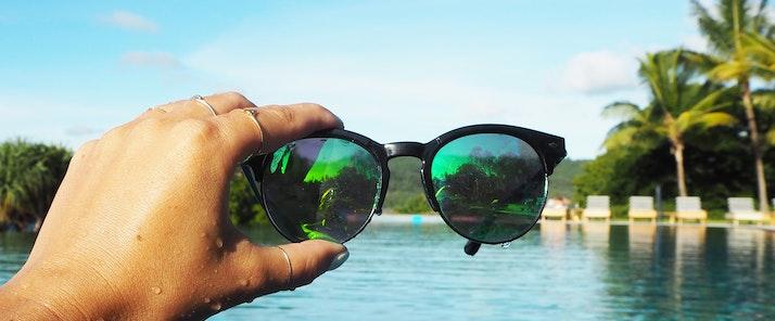 Lisa Hamilton SeeWantShop in pool at qualia holding sunglasses