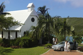 Wedding cars at the All Saints Chapel on Hamilton Island
