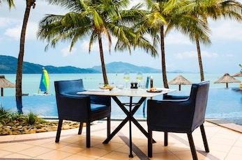 Enjoy breakfast by the pool - Holiday Beach Club holiday packages Hamilton Island