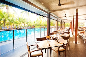 Hamilton Island holiday - Relax with a meal on the Pool Terrace- holiday package Hamilton Island