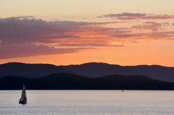 Sail a yacht at sunset around the Great Barrier Reef - Hamilton Island luxury resort
